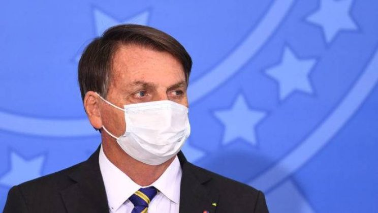 Brazilian President Jair Bolsonaro attends the launch of the Rural Women's Rights program at Planalto Palace in Brasilia, on July 29, 2020. - This is the first public appearance of Bolsonaro in an official event after he tested negative for COVID-19 coronavirus. (Photo by EVARISTO SA / AFP)
